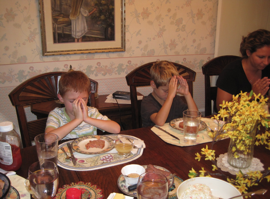 Grace before the ham loaf dinner, circa 2010 Patrick, Curtis, and Sarah